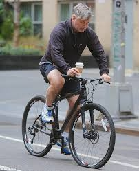 Alec baldwin on bicycle